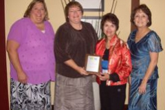 Dr. Radd with Linda Allen, a former student and recipient of the Inviting School Award, Janet and another colleague.