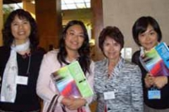 Dr. Radd presented Embracing Our Humanity With Humility and Humor at the 2008 IAIE World Conference in Chicago. Here she is with professionals from Hong Kong discussing GWG books.