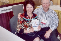 Dr. Radd with Dr. William Glasser, Theorist, purchasing a copy of his book at the ACA Convention in Kansas City, Missouri. April 2004.
