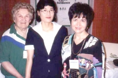 Dr. Radd and Dr. Myung Sook Lee, Department of Education, Taegue National University of Education, Taegue, Korea, presenters of program on International Perspectives of Developmental Guidance, with Sophia Radd in exhibit area.