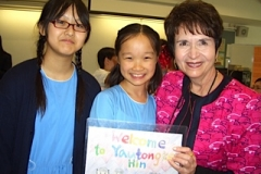 Dr. Radd with students at a school visit in Hong Kong