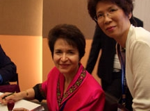Dr. Radd signing books at the International Alliance of Invitational Leadership Conference in Hong Kong, China, in September 2005.