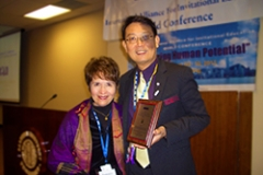 Dr. Radd receiving acknowledgement for being on the Board of Trustees for the International Alliance for Invitational Education.