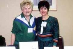 Dr. Radd and Sophia Radd at exhibit at the Nebraska Counselors Association 2000 Conference in Omaha, Nebraska