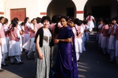 Dr. Radd with teacher and students outside St. Anthony's, a private girls school in Agra, India, on a visit in November 2000.